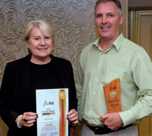 Representing category sponsor, PPM, Glywnnis Wells presents the gold medal to DBC Plastics' Rogan Robertson.
